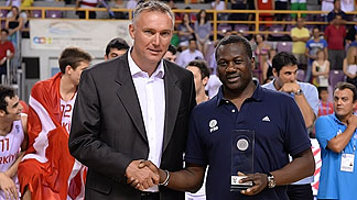 FIBA Europe Secretary General Kamil Novak presents France head coach Jean Aimé Toupane with the Fair Play Award